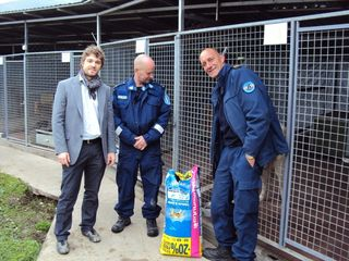 EULEX_staff_donate_food_to_dog_shelter